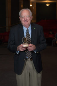 Man with award