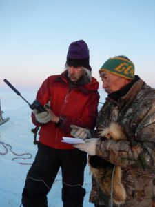 color photo of Joel Berger and Fred Goodhope Jr., conducting research in Alaska