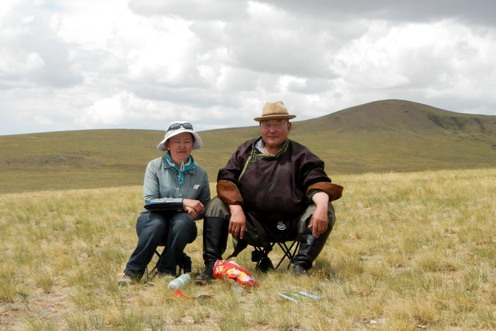 color photo of researcher Chantsaa Jamsranjav with herder Khurel in the Undurshireet soum, Tuv province of Mongolia