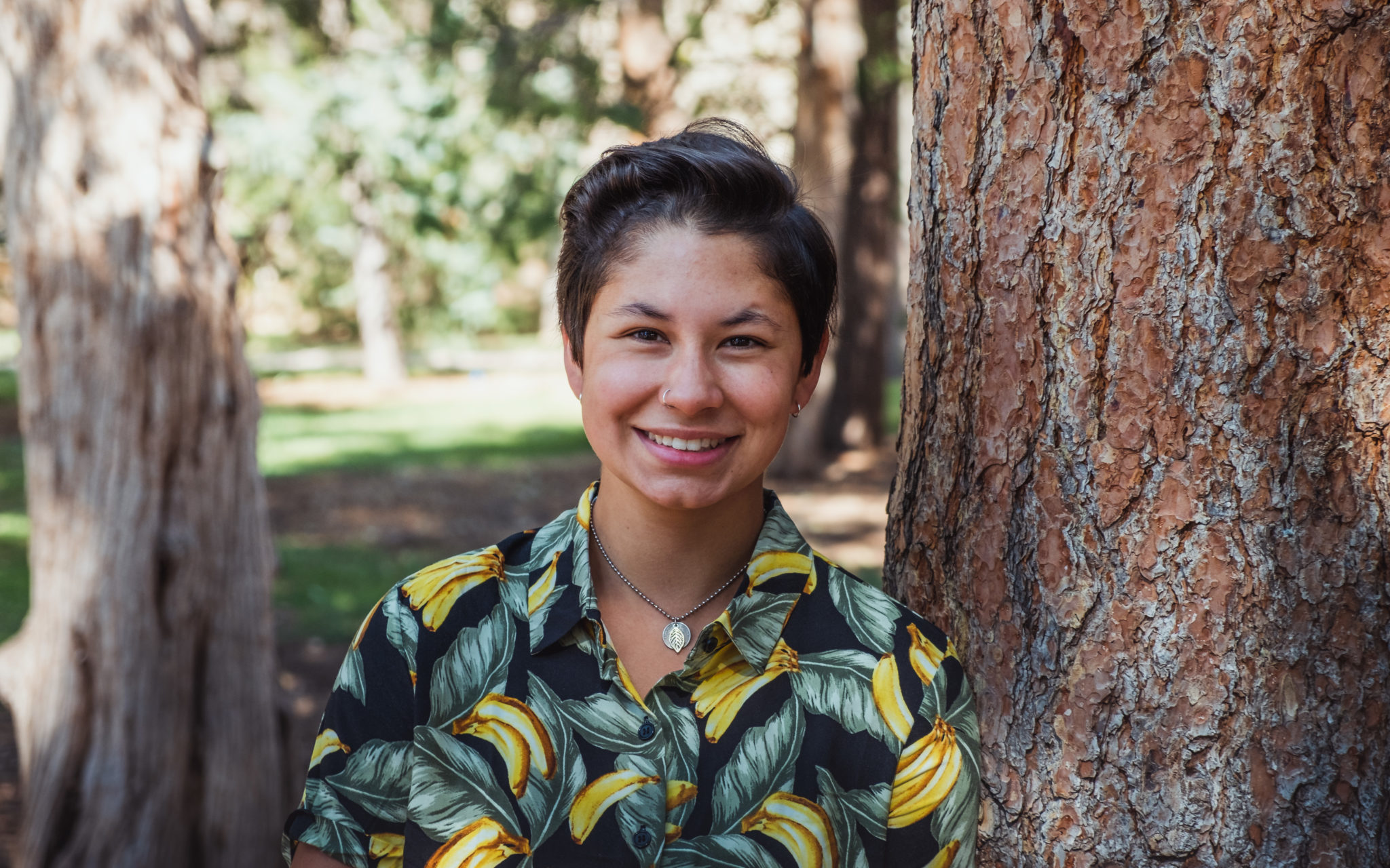 ecology student by tree