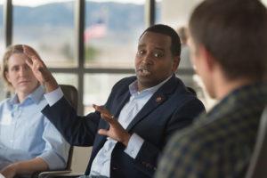 Rep. Joe Neguse talks with Warner College students at CSU