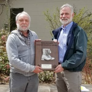 Mike Lester, head of the Colorado State Forest Service, presents Pete Barry with the Paul Gleason Lead by Example award