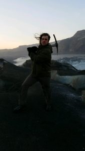 Outstanding grad Bradley Simms in Iceland holding pickax in dramatic fashion