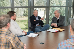 Bob Tate discussing conservation around a conference room table