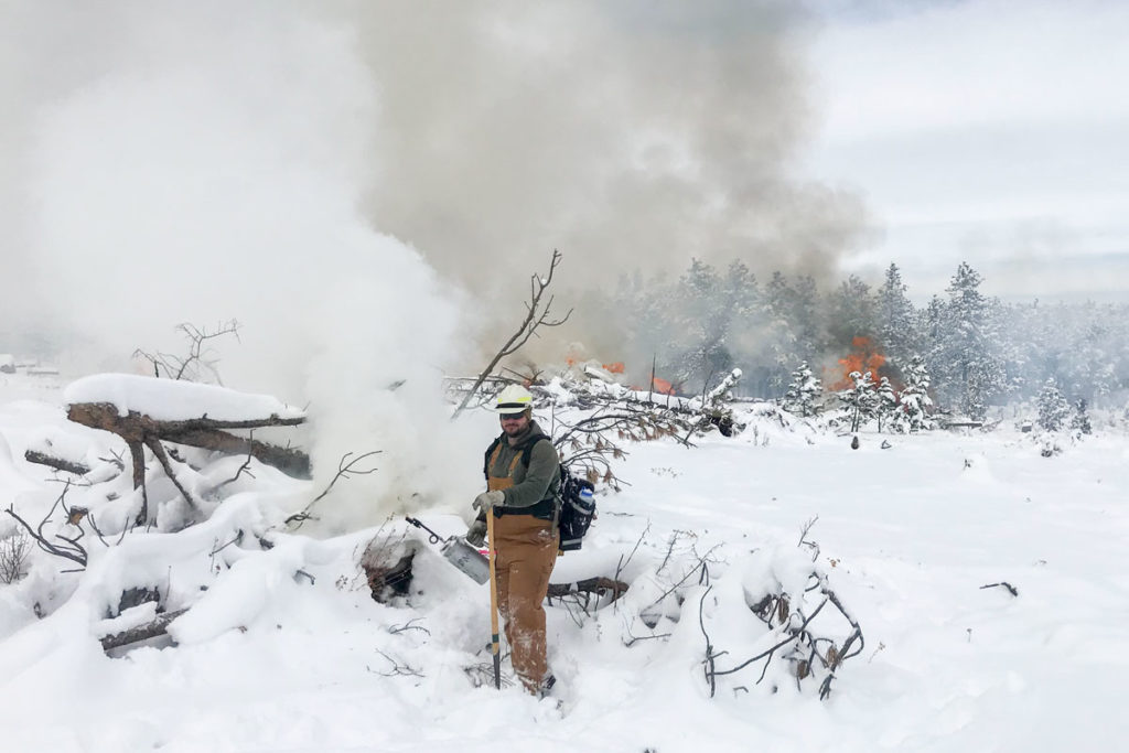 CSU SAFE student at a winter pile burning