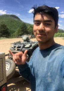 USFS intern stands by an ATV