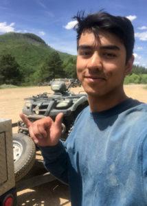 USFS intern stands by an ATV