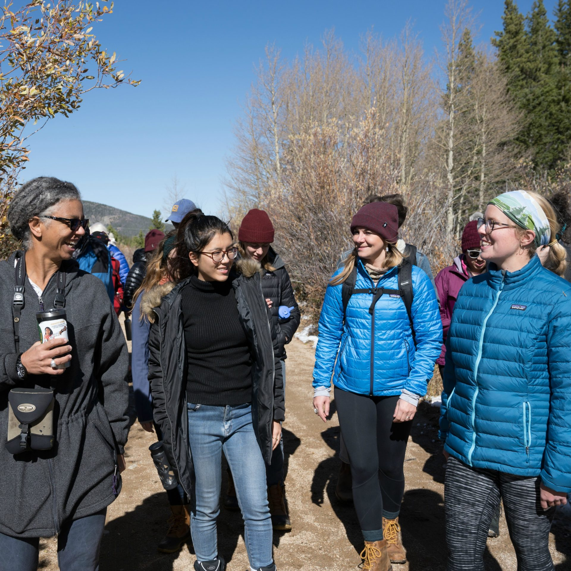 Gillian Bowser hikes with graduate students at CSU's Mountain Campus