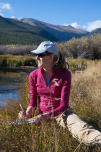 Sara Rathburn conducting research on the banks of the south fork of the poudre river