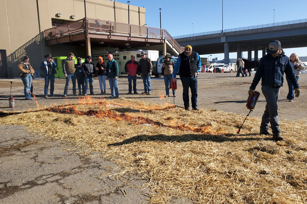 straw burning demonstration in parking lot