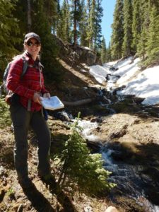 Nikki Seymour conducting field work in the mountains