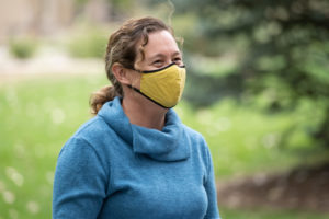 Monique Rocca wearing a mask on campus