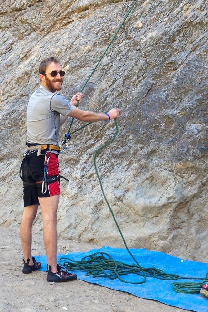 rock climber belaying