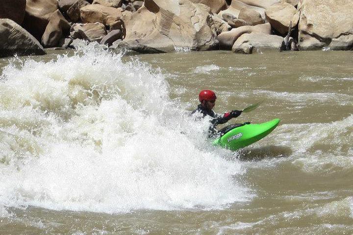 Man kayaking in white water