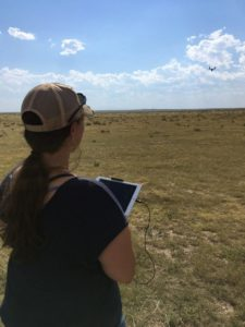 Vogeler conducting a test UAS flight at a local prairie.