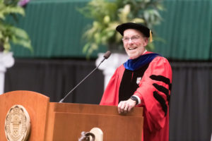 Dean John Hayes speaking at commencement