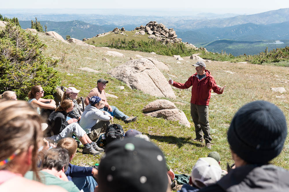 Dean John Hayes addresses NR220 class in alpine area near Mummy Pass